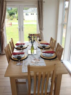 spacious dining area with patio doors