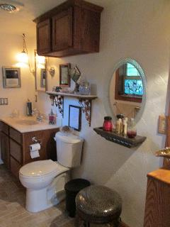Large bath with vanity & dressing area.