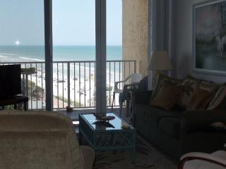 Living room and view of beach and town