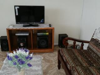 Flat screen cable T.V in air-conditioned living room