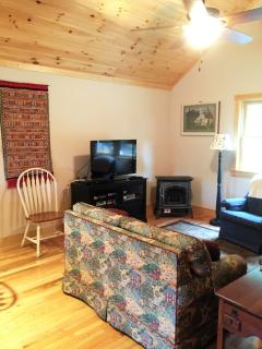 Living room is cozy with a gas stove but you can stay connected if you wish.