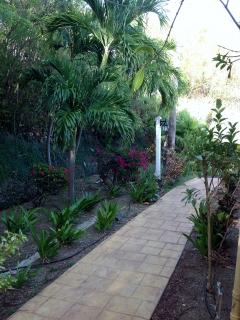 Only a few steps from the car down this lush walkway to your oasis!