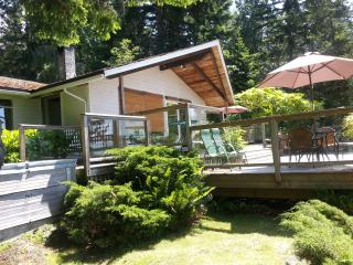 Front of cottage with bamboo blinds