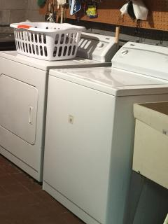 Basement level laundry with full size washer and dryer.