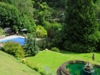 The swimming pool and the pond viewed from the top terrace outside Riversdale Lodge