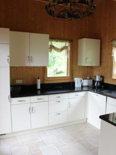 Kitchen with microwave, kettle, toaster, filter coffee maker, dishwasher