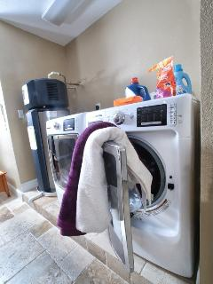 there is a washer and a dryer in the house