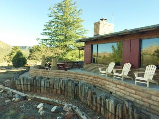 Front of house with large patio view various redrock formations