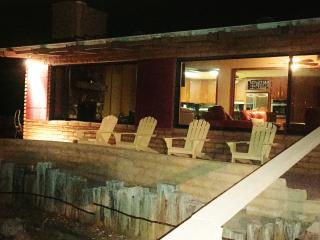 Front of house with large patio view various redrock formations...at night perfect for stargazing