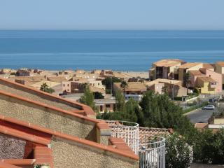 Looking down the terrace of 5 houses toward the Mediterranean Sea close by