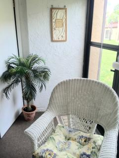 nice Lanai for relaxing leading to back door patio
