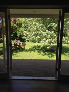 view of garden from apartment french doors
