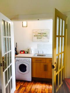 Utility room located off the kitchen (washing machine, dryer and drinks fridge plus sink)