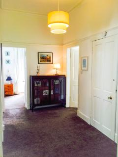 Hallway with access to all 3 bedrooms, sitting room, kitchen and bathroom