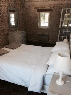 Bedroom at far end of corridor overlooking kitchen garden