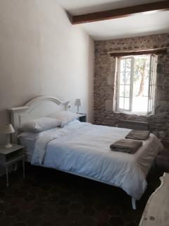 Bedroom at far end of corridor overlooking pool