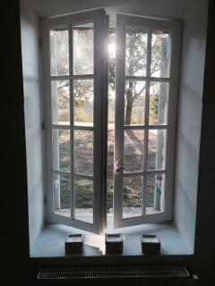 Bathroom window overlooking pool garden