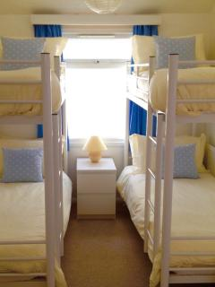 Bedroom 3 has two sets of bunk beds and is an ideal room for up to four children to share.