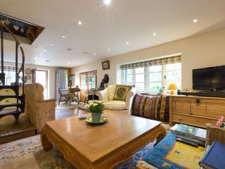 Comfortable sitting room leading to dining area and french windows to garden