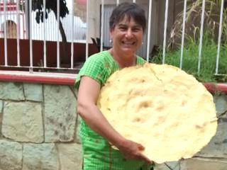 The owner, Mary Jane, showing off the largest corn tlayuda she's ever found and eaten!