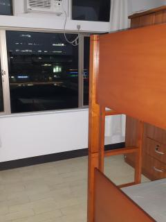 2nd bedroom with double bunk beds.  The room is facing Gateway Mall.