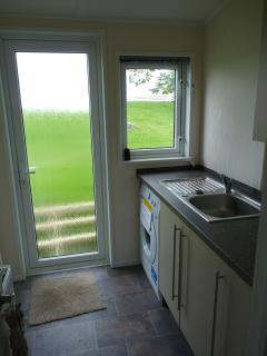 Useful utility room with washing machine