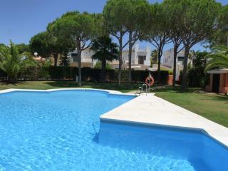 large communal pool looking towards villa