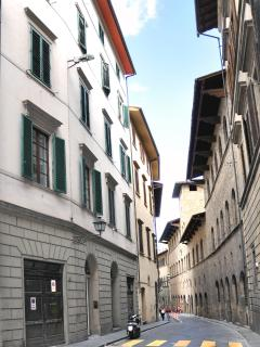 building on left side of street