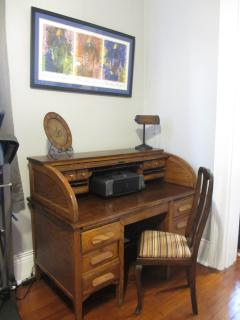 antique roll-top desk with printer and office supplies - Free & secure high speed wireless internet