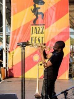 take an easy walk or bike ride to the Fairgrounds for Jazz Fest~experience a world of music and art