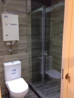 Master bathroom with shower unit