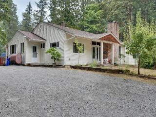 Dog-friendly riverfront retreat for entertaining with private hot tub!
