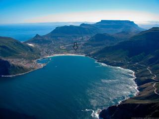 View of Hout Bay, Table Mountain in the background, arrow shows location of the house