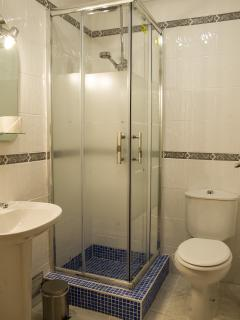 Family bathroom with shower cubicle and basin