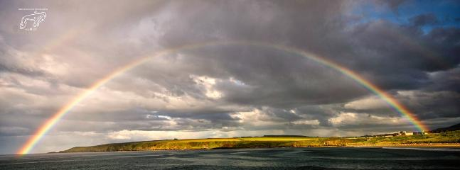 Rainbow over Sandend bay, Redhythe farm in the middle