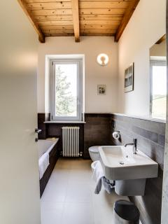 The family bathroom has a bath and a separate shower