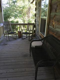 The back deck/balcony overlooks woods