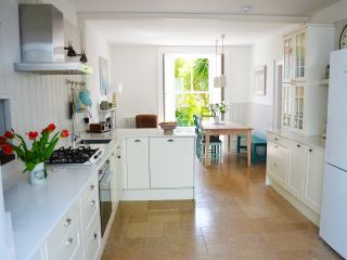 A spacious well equipped kitchen, open plan to dining area