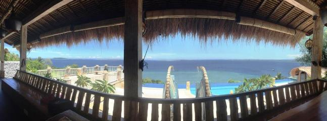 View from the lounge facilities over North Lombok's Mt. Rinjani and the Gili Islands