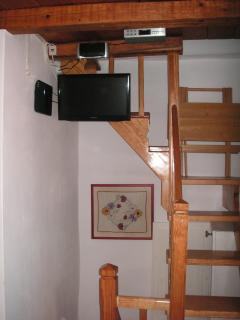 Bedroom - 3. DVD, tv, ceiling radio and stairs leading to the terrace.