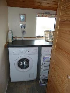 Utility Room with washing machine and tumble drier.