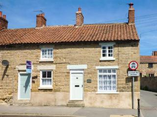 LOCKTON COTTAGE, end-terrace, open fire, off road parking, garden, in Pickering,