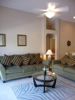Bright and air open concept living area. 50 inch TV