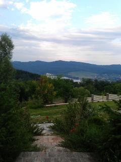 General view from the  garden over the river and mountains