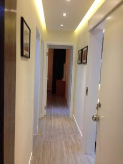 Hallway with recess lighting to bedrooms and bathrooms.