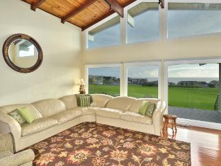 Large living room with 10th green views