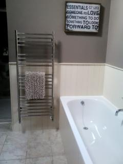 Smart bathroom with underfloor heating and heated towel rail
