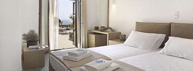 Typical bedroom: garden and Aegean Sea views
