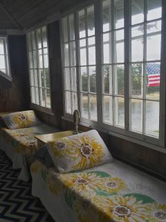 Sleeping porch on second floor with 2 cots