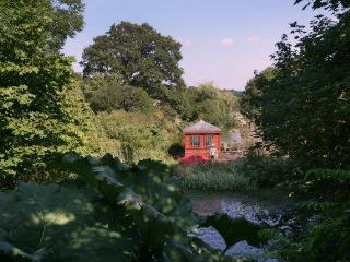 The summer house by the lake where you can enjoy the wildlife and a drink from the mini-bar!